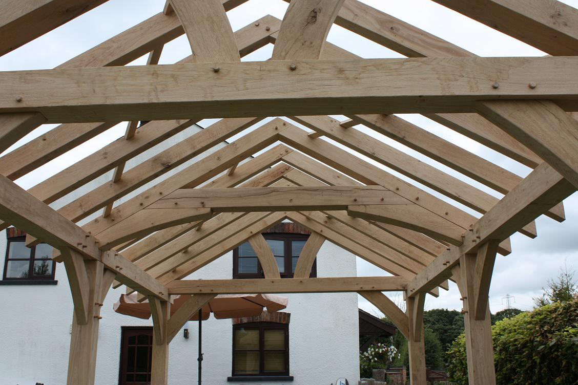 Oak timber roof trusses cheapest prices uk king for Wooden roof trusses prices
