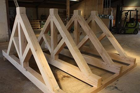 Green oak roof truss design manufacturers oak timber for Truss roof cost