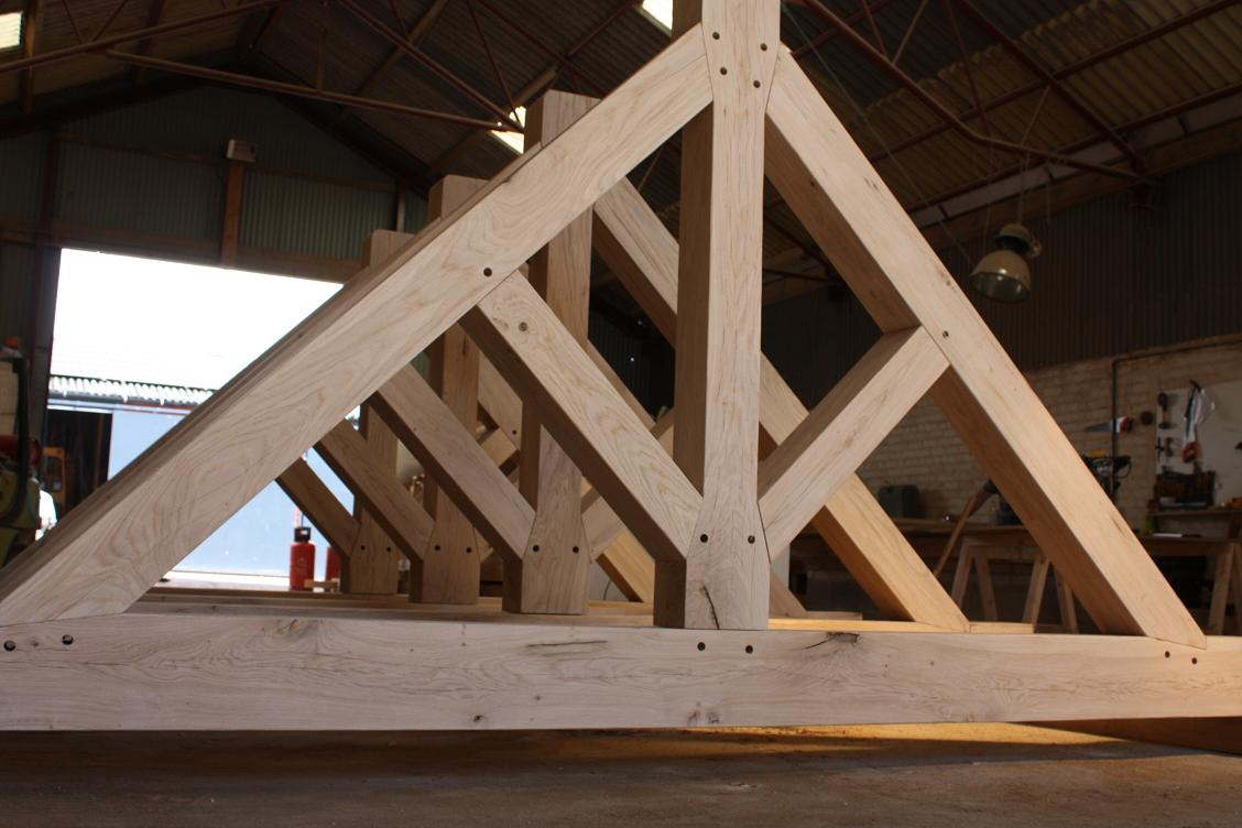 Oak timber framing tied king post truss in oak example for Wooden roof trusses prices